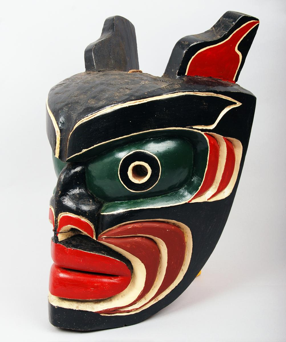 Mask of the being Bookwus (cockle hunter), painted red cedar, Vancouver Island, Canada