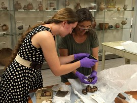 Tlingit artist Shelly Laws examines ethnographic items from Alaska, assisted by a student in an Archaeology Internship course (2015).